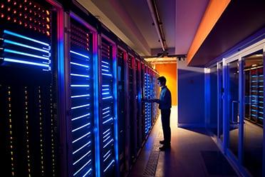 Technician working in a data center